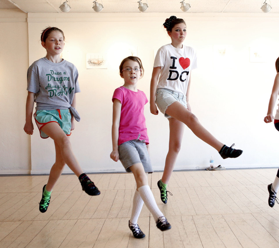 Photo - Lauren Sager, Camryn Odell and Madison Butler dance as children take an Irish Dancing class at Sonder Music, Dance & Arts on Friday, April 12, 2013 in Norman, Okla.  Photo by Steve Sisney, The Oklahoman