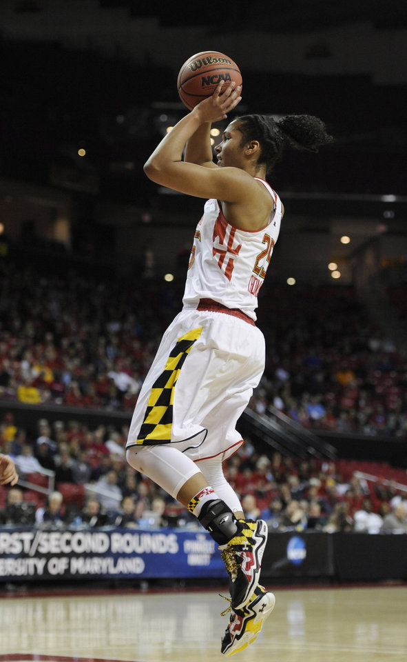 Photo - Maryland's Alyssa Thomas shoots against Army during the first half of the first round of the NCAA women's college basketball tournament on Sunday, March 23, 2014, in College Park, Md. (AP Photo/Gail Burton)