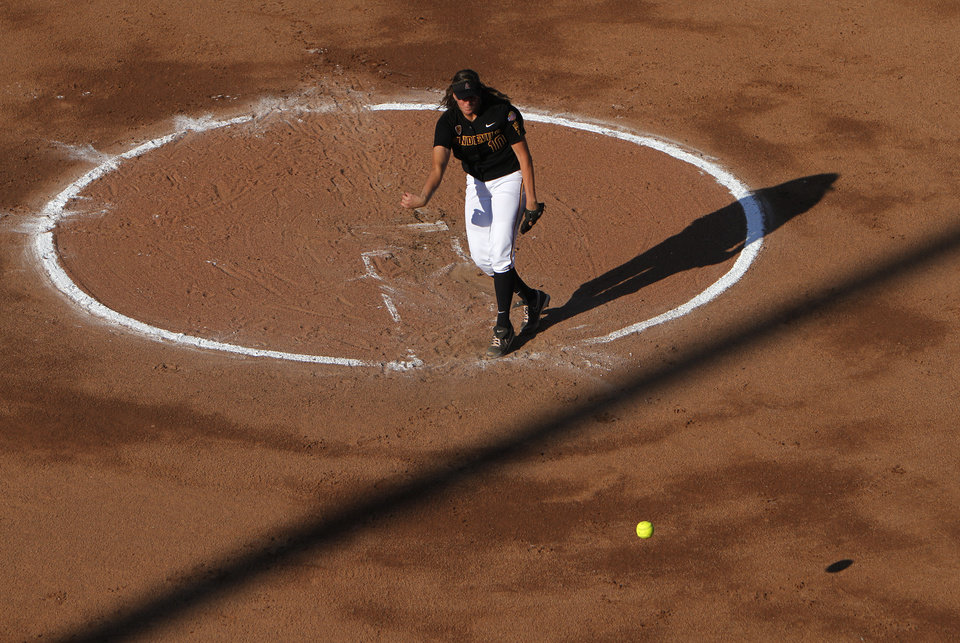 Arizona's Hillary Bach (10) pitches during a Women's College World Series game between Arizona State and LSU at ASA Hall of Fame Stadium in Oklahoma City, Saturday, June 2, 2012. Photo by Garett Fisbeck, The Oklahoman