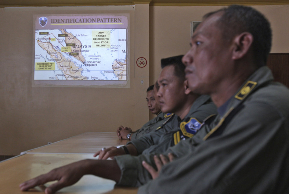 Photo - An operation map is displayed on the wall as Indonesian Air Force personnel listen to a briefing following to a search mission for the missing Malaysia Airlines Boeing 777 that was conducted over the Strait of Malacca, at Suwondo air base in Medan, North Sumatra, Indonesia, Wednesday, March 12, 2014. Malaysia asked India to join the expanding search for the missing jetliner near the Andaman Sea, far to the northwest of its last reported position and a further sign Wednesday that authorities have no idea where the plane might be more than four days after it vanished. (AP Photo/Binsar Bakkara)