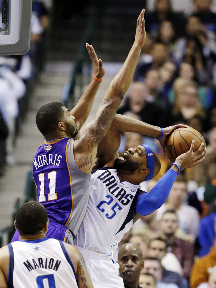 Phoenix Suns' Markieff Morris (11) defends as Dallas Mavericks' Vince Carter (25) attempts a shot in the first half of an NBA basketball game, Sunday, Jan. 27, 2013, in Dallas. (AP Photo/Tony Gutierrez)