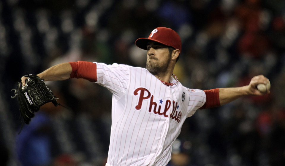 Photo - Philadelphia Phillies starting pitcher Cole Hamels throws against the New York Mets in the first inning of a baseball game Tuesday, April 29, 2014, in Philadelphia. (AP Photo/H. Rumph Jr)