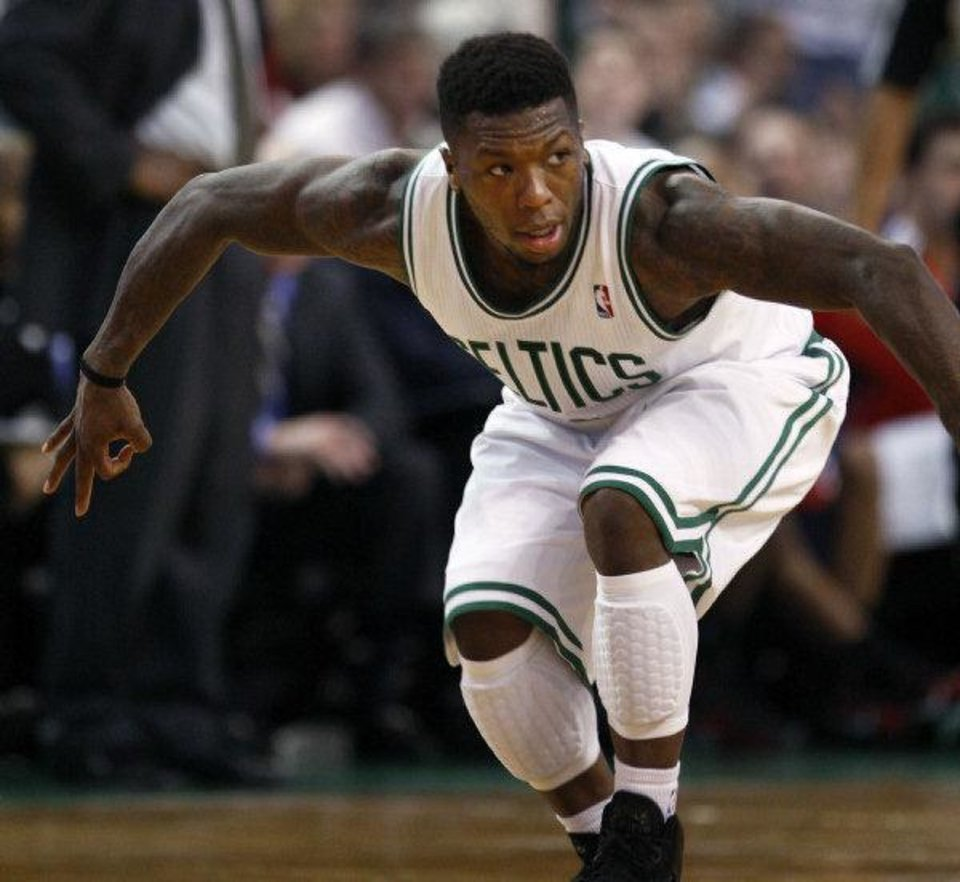 Photo - The Thunder acquired former Boston Celtics guard Nate Robinson in a trade on Thursday. PHOTO BY JIM DAVIS, Courtesy The Boston Globe  Jim Davis/Globe Staff