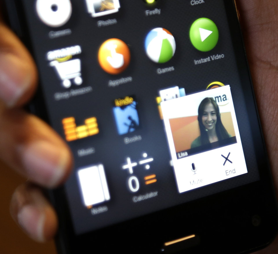 "Photo -  In this file photo, the Amazon ""Mayday"" customer service app that provides a direct link to a live Amazon tech support worker, is demonstrated on the new Amazon Fire Phone, in Seattle. AP Photo   Ted S. Warren -  AP"