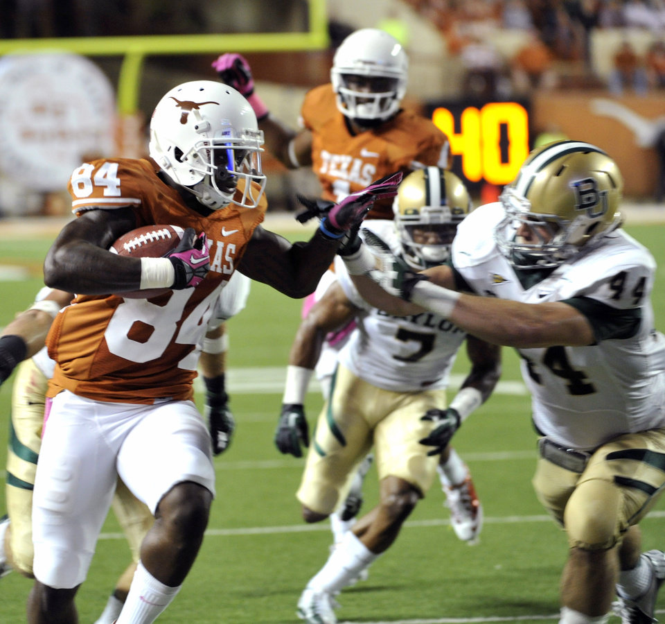 Photo -   Texas receiver Marquise Goodwin (84) runs against Baylor linebacker Bryce Hagar (44) in the first quarter of an NCAA college football game on Saturday, Oct. 20, 2012, in Austin, Texas. (AP Photo/Michael Thomas)