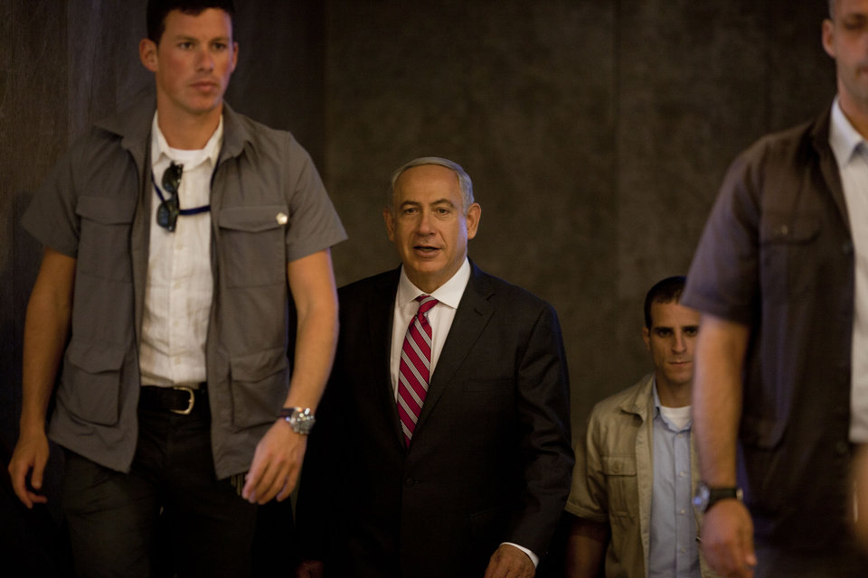 Photo - Israeli Prime Minister Benjamin Netanyahu arrives to the weekly cabinet meeting in Jerusalem, Sunday, Oct. 13, 2013. (AP Photo/Ariel Schalit, Pool)