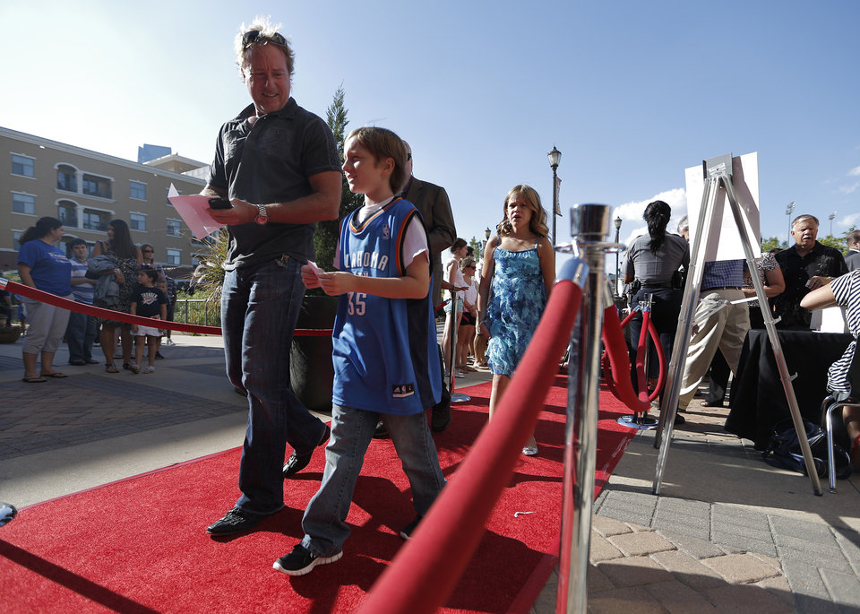 Fans walk the into the theatre during the red carpet premiere of Thunderstruck at Harkins Bricktown Theatre in Oklahoma City, Sunday, Aug. 19, 2012.  Photo by Garett Fisbeck, For The Oklahoman