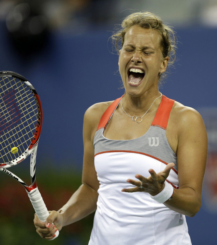 Photo - Barbora Zahlavova Strycova, of the Czech Republic, reacts after a shot to Eugenie Bouchard, of Canada, during the third round of the 2014 U.S. Open tennis tournament Saturday, Aug. 30, 2014, in New York. (AP Photo/Darron Cummings)