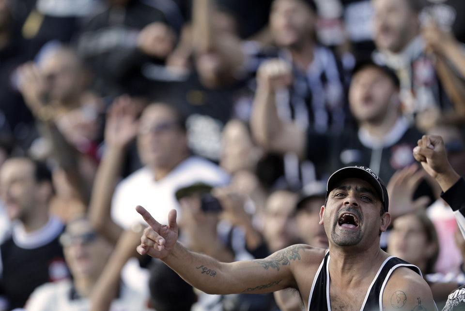 Photo - Corinthians' supporters cheer during a Brazilian soccer league match against Flamengo in Sao Paulo, Brazil, Sunday, April 27, 2014. (AP Photo/Andre Penner)