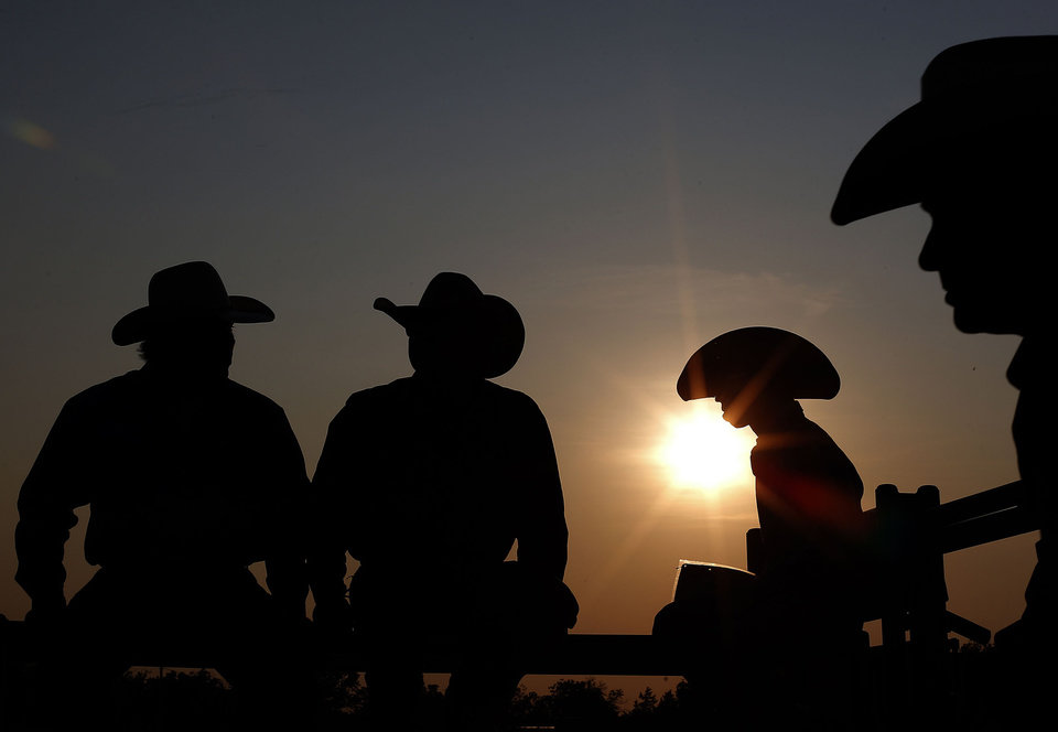 Cowboys wait for the beginning of the International Youth Finals Rodeo in Shawnee, Okla., Sunday, July 7, 2013. Photo by Sarah Phipps, The Oklahoman