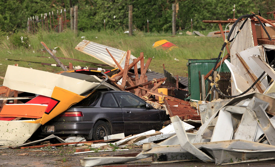 A car in the parking lot of Love's store south of Interstate 40 at Choctaw Rd., is covered with debris from the building's storefront and awning,  Monday evening, May 10, 2010.   Photo by Jim Beckel, The Oklahoman
