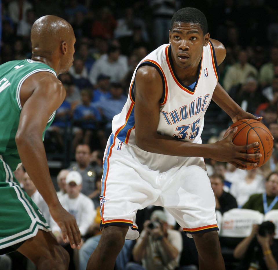 Photo - Oklahoma City's Kevin Durant looks past the defense of Boston's Ray Allen in the first half during the NBA basketball game between the Oklahoma City Thunder and the Boston Celtics at the Ford Center in Oklahoma City, Wednesday, Nov. 5, 2008. BY NATE BILLINGS, THE OKLAHOMAN