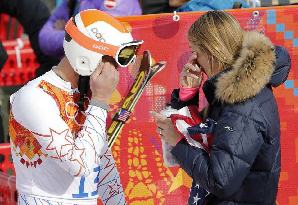 Photo - United States' Bode Miller and his wife, Morgan wipe away tears after after finishing third in the men's super-G at the Sochi 2014 Winter Olympics, Sunday, Feb. 16, 2014, in Krasnaya Polyana, Russia. (AP Photo/Christophe Ena)