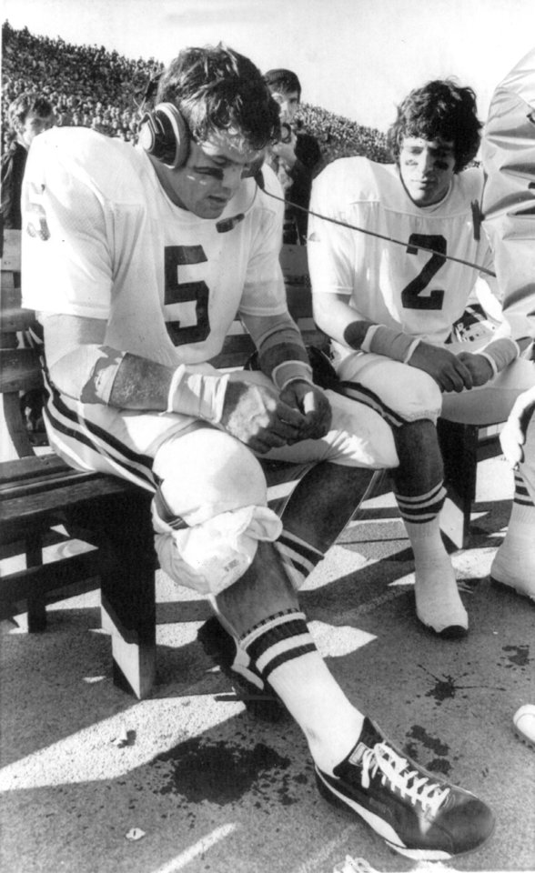 "OU FOOTBALL Steve Davis 11-17-74;  ""Trying to solve the problem of a Kansas team which trailed only 21-14 after three quarters, Sooner quarterback Steve Davis listens carefully to instructions from the press box.""  The Sooners beat the Jayhawks handily, 45-14.  Staff photo by Jim Argo taken 11/16/74; photo ran in the 11/17/74 Daily Oklahoman.  File:  Football/OU/OU-Kansas/Steve Davis/1974"