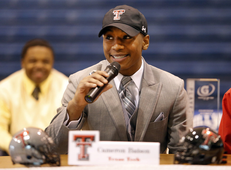 Photo - Millwood's Cameron Batson signed to play football for Texas Tech during signing day at Millwood High School in Oklahoma City, Wednesday February 05, 2014. Photo By Steve Gooch, The Oklahoman