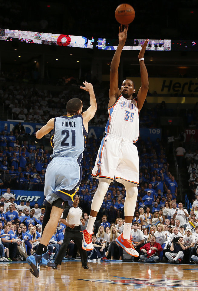 Photo - Oklahoma City's Kevin Durant (35) shoots over Memphis' Tayshaun Prince (21) during Game 2 in the first round of the NBA playoffs between the Oklahoma City Thunder and the Memphis Grizzlies at Chesapeake Energy Arena in Oklahoma City, Monday, April 21, 2014. Photo by Nate Billings, The Oklahoman