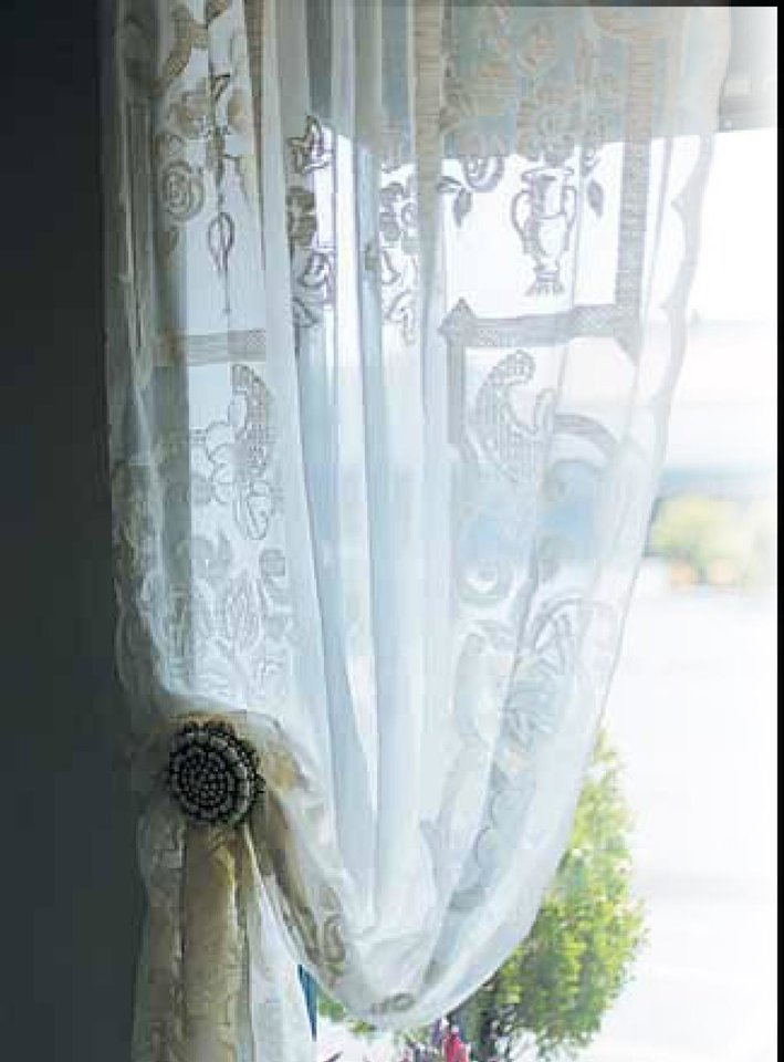 "1. FLORAL ON WHITE Probably the strongest trend for 2013 is a white background scattered with bold colors and vintage patterns, small and large florals. said Janis Bevers of Oklahoma City-based Living in Style. In this trend is a nod to ""feminine strength."" Look for crumpled effects. In lace, look for stitched and frayed finishes.  LACE CURTAIN COURTESY OF FABRIC FACTORY, OKLAHOMA CITY"