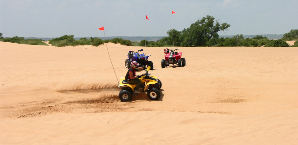 Riders take on the 70-foot sand dunes on their ATVs at Little Sahara State Park. PHOTO PROVIDED. <strong></strong>