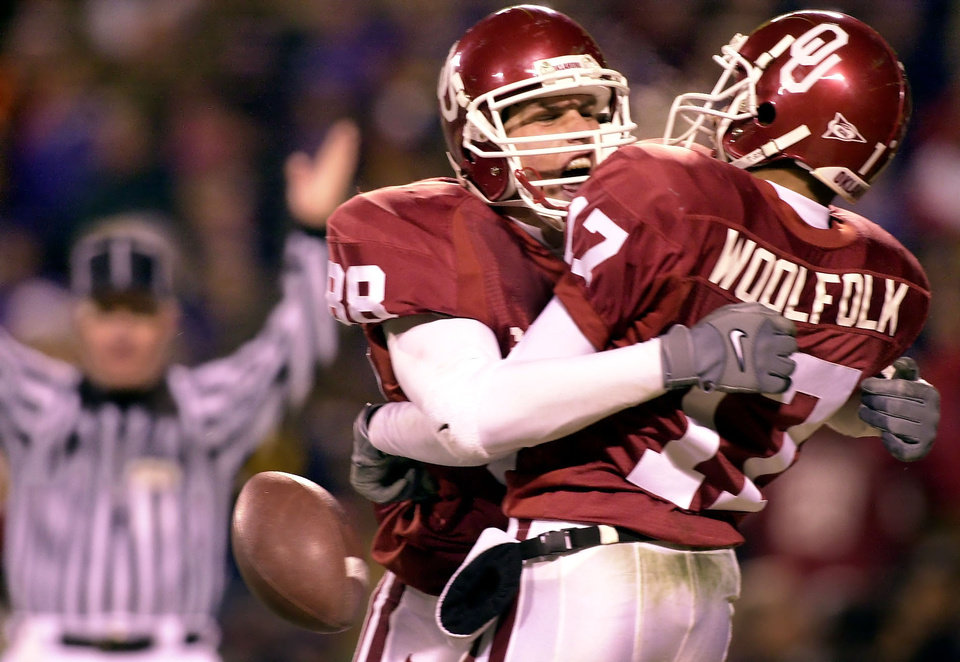 Former OU tight end Trent Smith, left, and receiver Andre Woolfolk celebrate during the Sooners' win in the 2000 Big 12 championship game. OKLAHOMAN ARCHIVE PHOTO