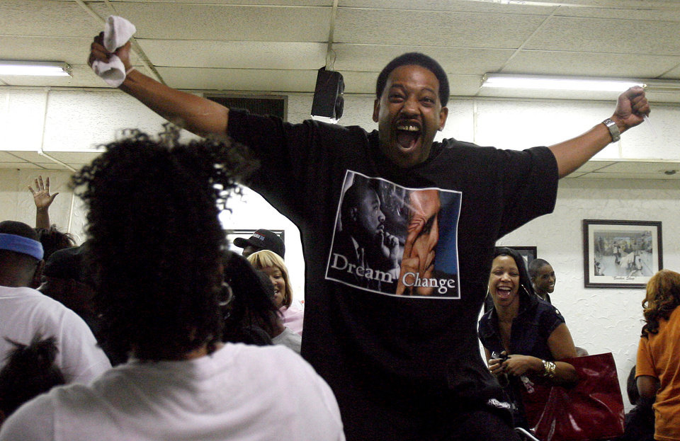 Photo - Corey Sutter, of Atoka, Okla., celebrates after Barack Obama was elected the nation's first black president at the Images of Hair and Nails  salon Tuesday, Nov. .4, 2008, in Oklahoma City. PHOTO BY SARAH PHIPPS, THE OKLAHOMAN.