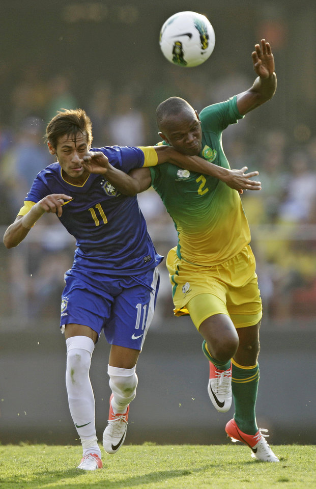 Photo -   Brazil's Neymar, left, heads the ball next to South Africa's Gaxa during a friendly soccer match in Sao Paulo, Brazil, Friday, Sept. 7, 2012. (AP Photo/Nelson Antoine)