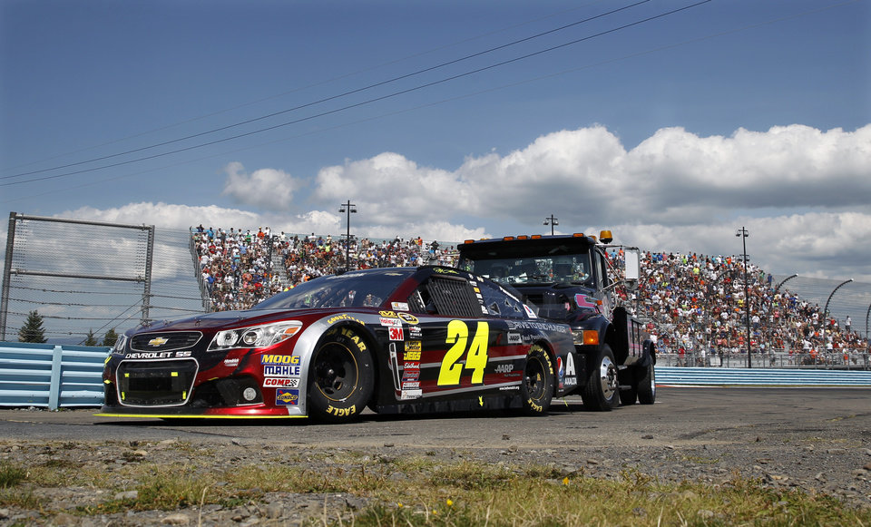 Photo - Jeff Gordon's  (24) is pushed back to the pits during a NASCAR Sprint Cup Series auto race at Watkins Glen International, Sunday, Aug. 10, 2014, in Watkins Glen N.Y. (AP Photo/Mel Evans)