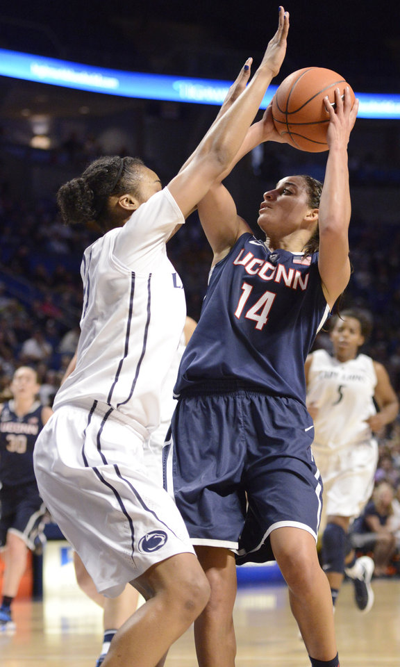 Photo - Connecticut's Bria Hartley (14) looks to shoot over Penn State's Ariel Edwards (23) in the second half of an NCAA college basketball game on Sunday, Nov. 17, 2013, in State College, Pa. Connecticut won 71-52. (AP Photo/John Beale)