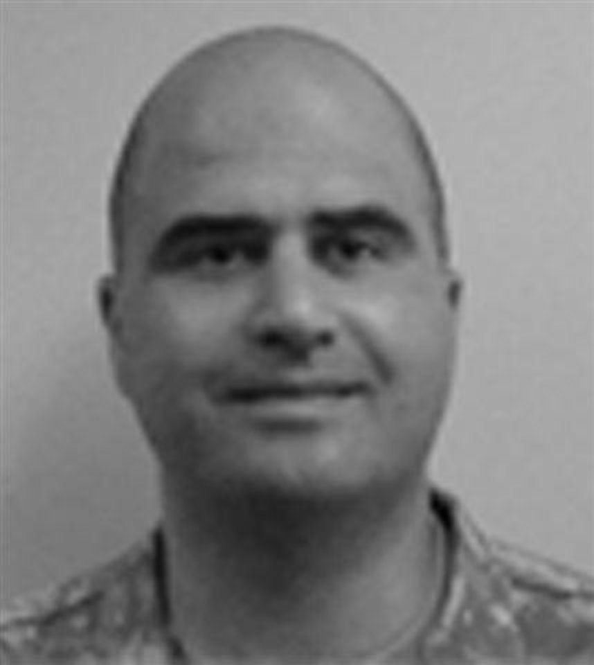 Photo - This photo from the Center for the Study of Traumatic Stress Web Site shows Nidal Malik Hasan. Military officials say the suspected shooter at Fort Hood, Texas on Thursday Nov. 5, 2009 was Maj. Nidal Malik Hasan. AP Photo