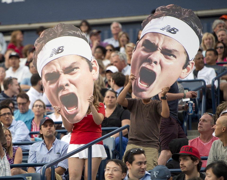 Photo - Fans of Milos Raonic, of Canada, hold posters during his 6-3, 4-6, 6-4 win over Julien Benneteau, of France, during a Rogers Cup tennis match in Toronto on Thursday, Aug. 7, 2014. (AP Photo/The Canadian Press, Frank Gunn)