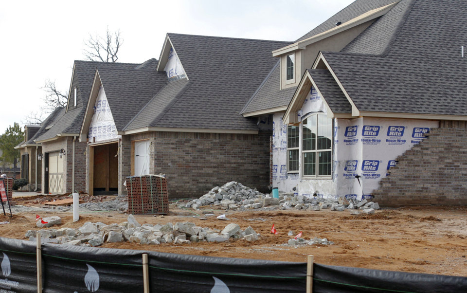 New single-family housing construction permits in Edmond are on the rise. Two streets of new homes are being built in Hampden Hallow, northeast of Covell Road and Air Depot Boulevard.  PHOTOS BY PAUL HELLSTERN, THE OKLAHOMAN