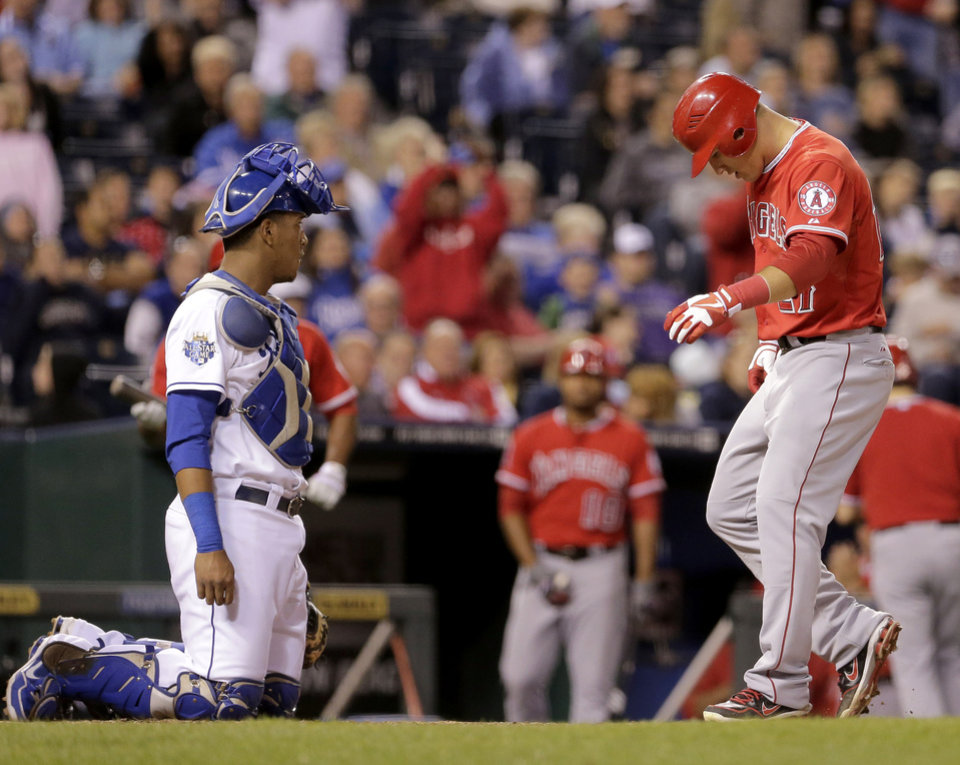 Photo -   Los Angeles Angels' Mike Trout, right, crosses the plate in front of Kansas City Royals catcher Salvador Perez to score the go-ahead run after Torii Hunter was walked with the bases loaded during the eighth inning of a baseball game on Friday, Sept. 14, 2012, in Kansas City, Mo. (AP Photo/Charlie Riedel)