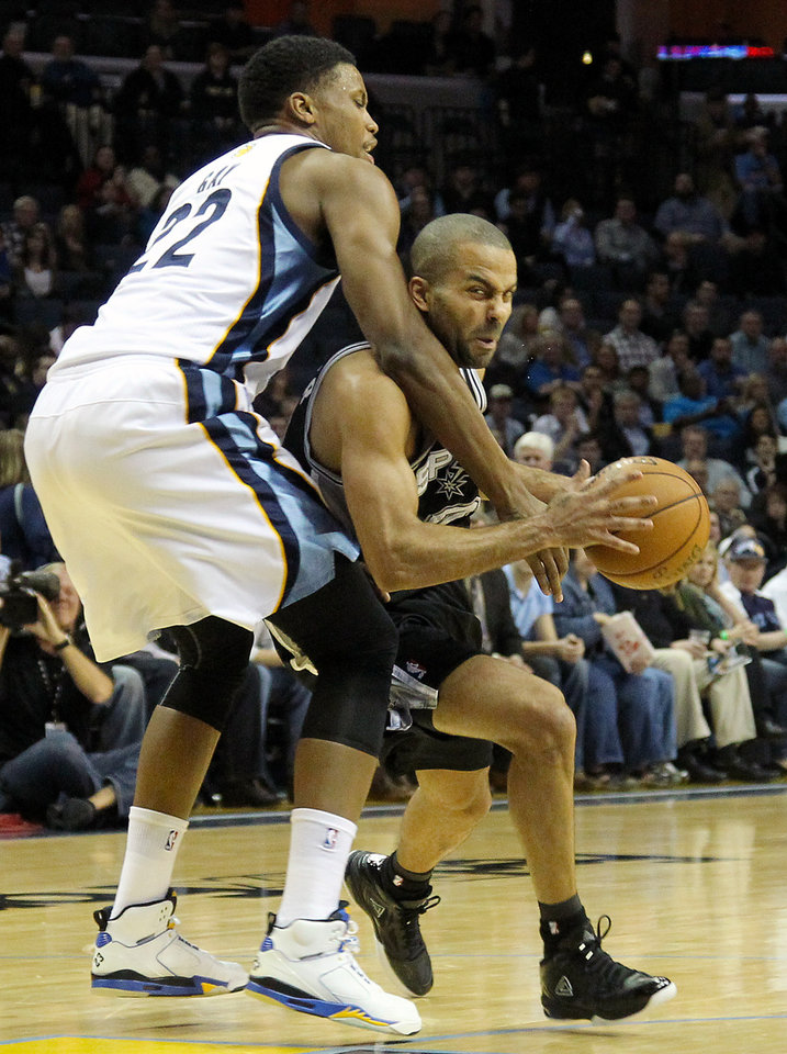 Photo - Memphis Grizzlies forward Rudy Gay (22) fouls San Antonio Spurs guard Tony Parker, of France, in the first half of an NBA basketball game on Friday, Jan. 11, 2013, in Memphis, Tenn. (AP Photo/Lance Murphey)