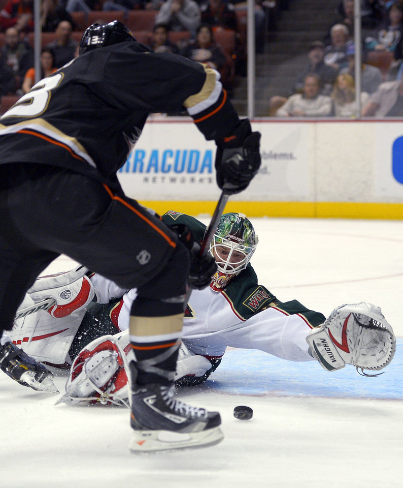 Minnesota Wild goalie Niklas Backstrom stops a shot by Anaheim Ducks center Nick Bonino during the second period of an NHL hockey game, Friday, Feb. 1, 2013, in Anaheim, Calif. (AP Photo/Mark J. Terrill)