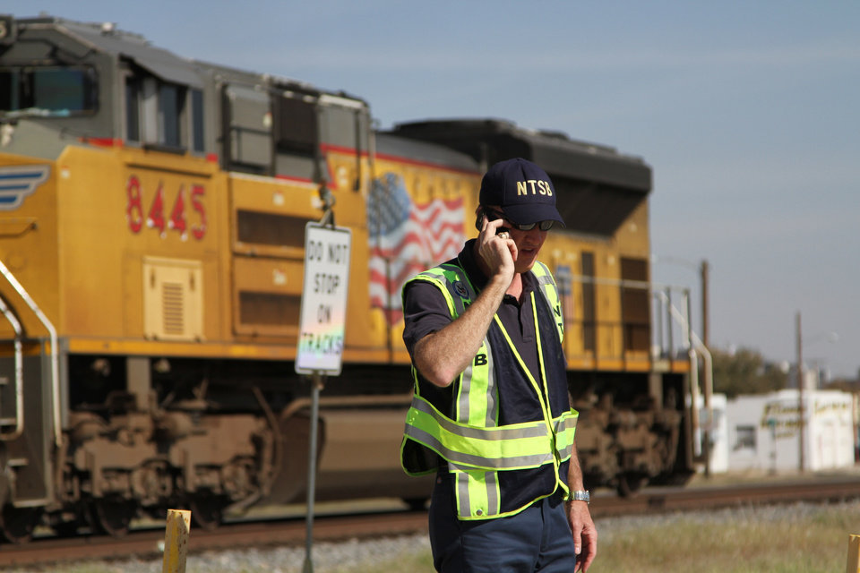 Photo -   A railroad investigator talks on the phone at the scene of an accident where four veterans were killed and 16 other people were injured when a train slammed into a parade float carrying the returning heroes to a banquet last Thursday in Midland, Texas on Saturday, Nov. 17, 2012. Federal investigators were trying to determine whether the two-float parade had been given enough warning to clear the tracks. (AP Photo/Juan Carlos Llorca)