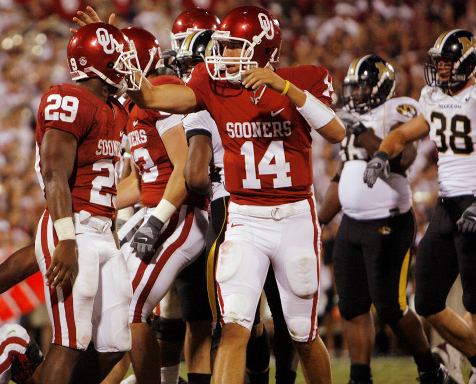 Photo - Oklahoma's Sam Bradford (14) and Chris Brown (29) celebrate after Brown's touchdown against Missourii during the second half of the college football game between  the University of Oklahoma Sooners (OU) and the University of Missouri Tigers (MU) at the Gaylord Family Oklahoma Memorial Stadium on Saturday, Oct. 13, 2007, in Norman, Okla.By CHRIS LANDSBERGER, The Oklahoman