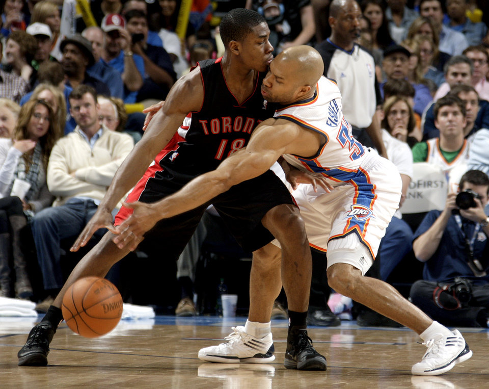 Oklahoma City\'s Derek Fisher (37) attempts to steal the ball from Toronto\'s Ben Uzoh (18) during the NBA basketball game between the Oklahoma City Thunder and the Toronto Raptors at Chesapeake Energy Arena in Oklahoma City, Sunday, April 8, 2012. Photo by Sarah Phipps, The Oklahoman.