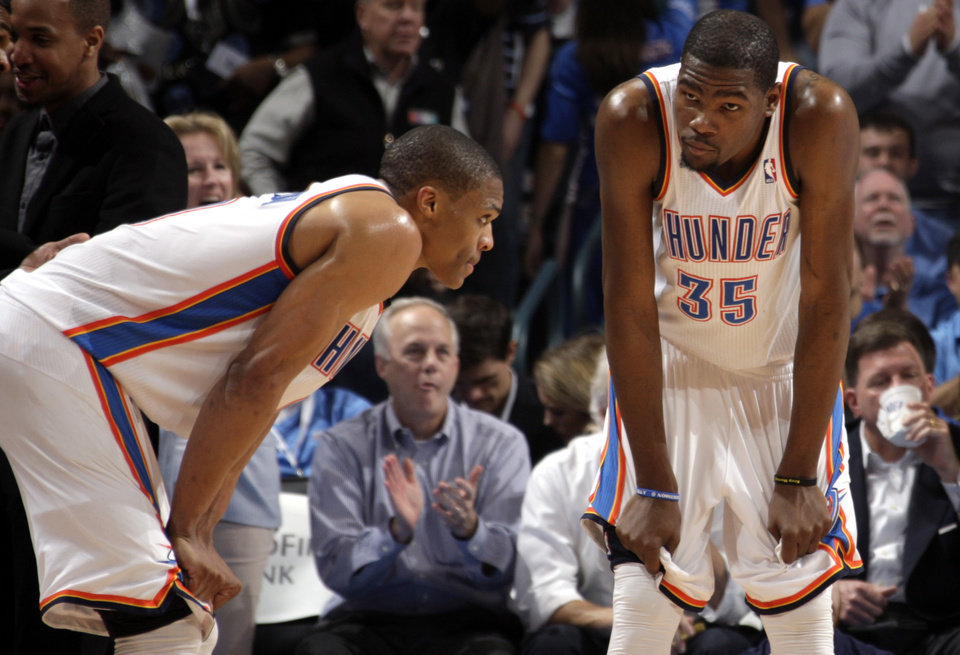 Oklahoma City's Russell Westbrook (0) and Kevin Durant (35) react during the NBA basketball game between the Oklahoma City Thunder and the Houston Rockets at the Chesapeake Energy Arena, Tuesday, March 13, 2012. Photo by Sarah Phipps, The Oklahoman.