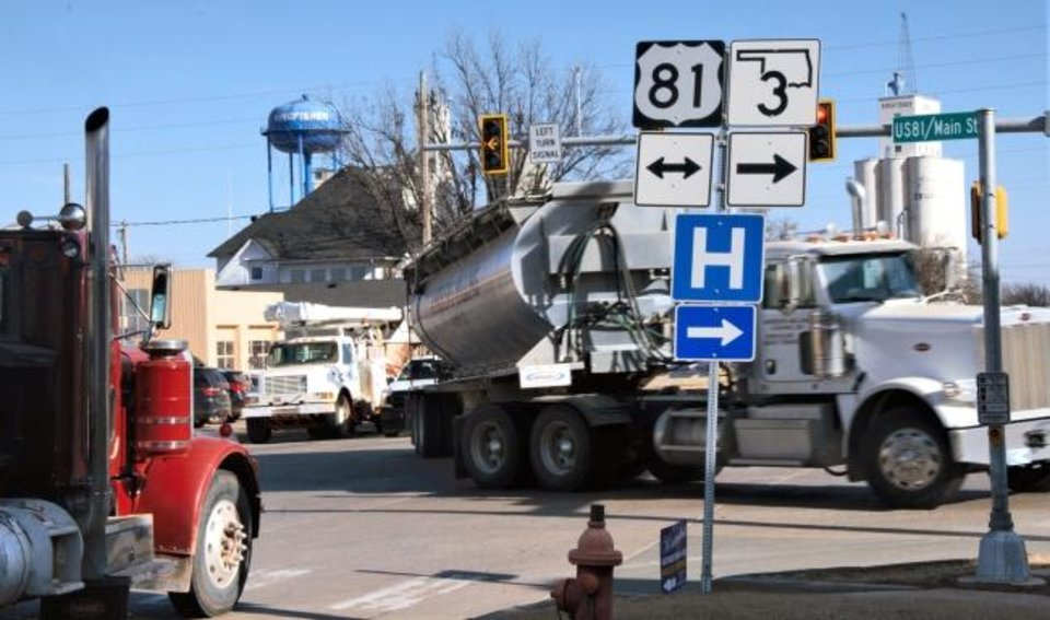 Photo -  Trucks navigate a busy intersection along State Highway 33 in Kingfisher earlier this year. [JACK MONEY/THE OKLAHOMAN ARCHIVES]