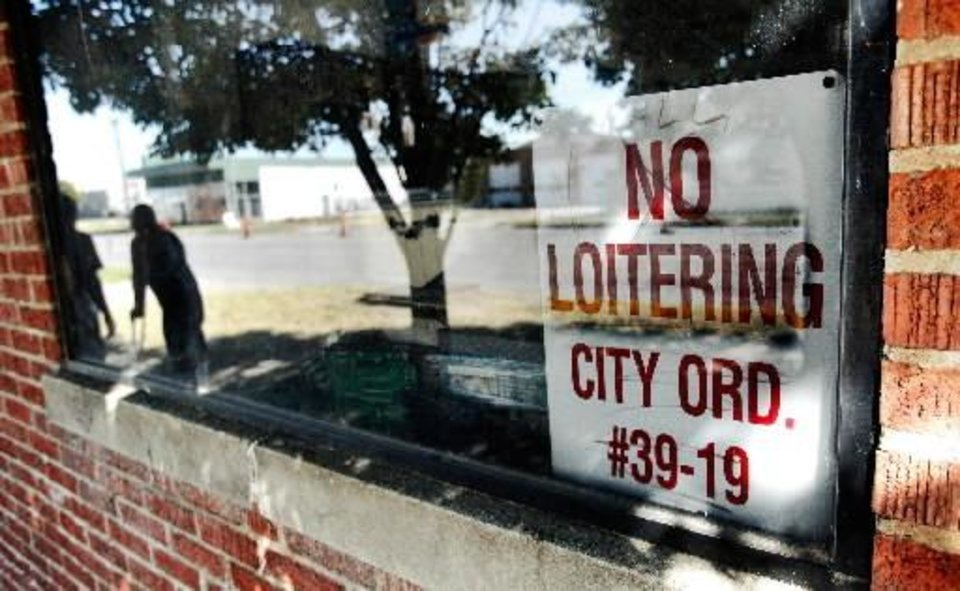 A sign is posted inside the front window of a small business on W Sheridan Avenue, near Shartel. Many homeless wander the area along Sheridan, California and Reno between Walker and Western. Photo taken Wednesday, Oct. 21, 2010. Photo by Jim Beckel, The Oklahoman