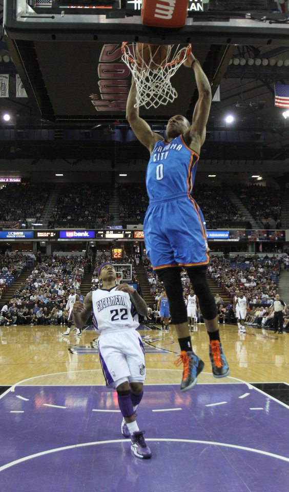 Oklahoma City Thunder guard Russell Westbrook, right, stuffs as Sacramento Kings guard Isaiah Thomas, left, looks on during the first quarter of an NBA basketball game in Sacramento, Calif., Friday, April 20, 2012. (AP Photo/Rich Pedroncelli) ORG XMIT: SCA101