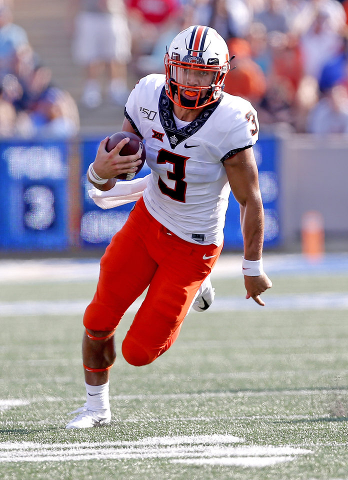 Photo - Oklahoma State's Spencer Sanders (3) rushes for a touchdown in third quarter during a college football game between the Oklahoma State University Cowboys (OSU) and the University of Tulsa Golden Hurricane (TU) at H.A. Chapman Stadium in Tulsa, Okla., Saturday, Sept. 14, 2019. [Sarah Phipps/The Oklahoman]