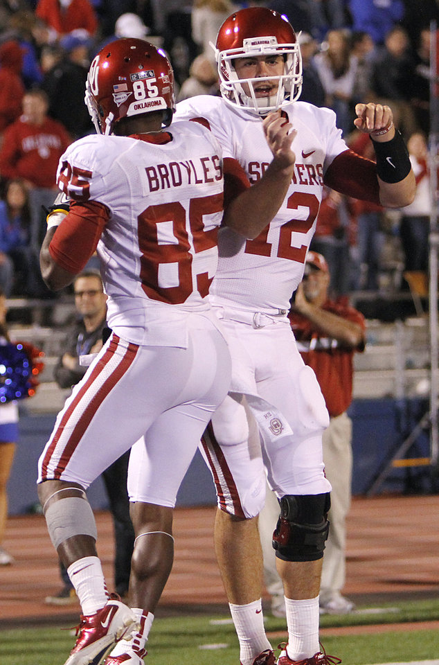 Oklahoma\'s Landry Jones (12) and Ryan Broyles (85) celebrate after scoring a touchdown during the college football game between the University of Oklahoma Sooners (OU) and the University of Kansas Jayhawks (KU) on Sunday, Oct. 16, 2011. in Lawrence, Kan. Photo by Chris Landsberger, The Oklahoman