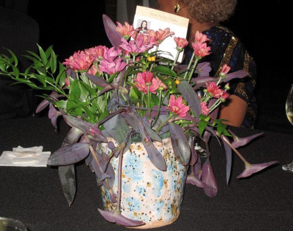 Decorations: Ceramic vases created by Southeast High School students filled with flowers were set on all the tables. (Photo by Helen Ford Wallace).