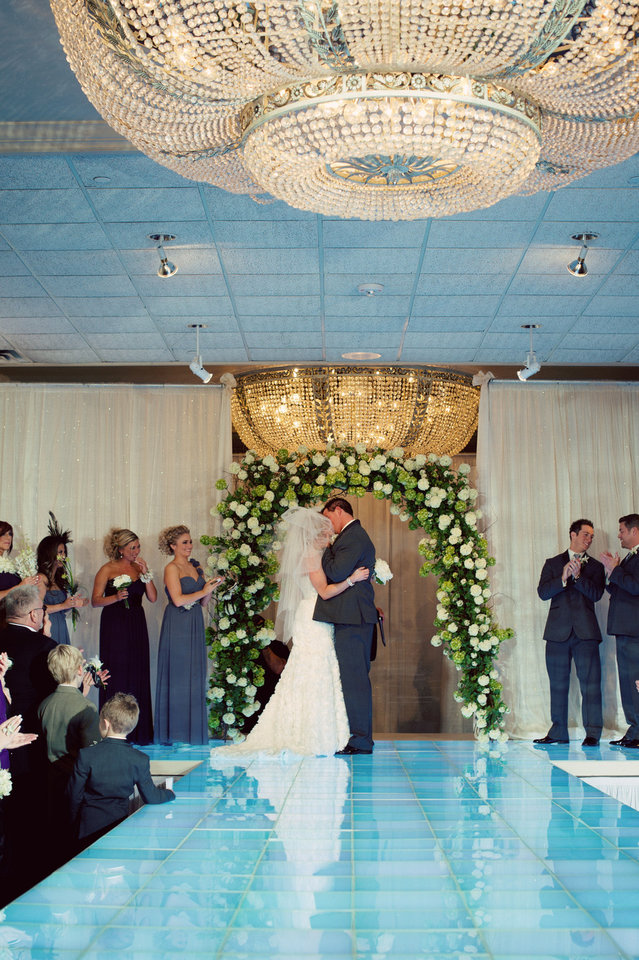 Photo - Michael and Malorie Gulikers kiss for the first time as husband and wife. Photo by Traina Photography.