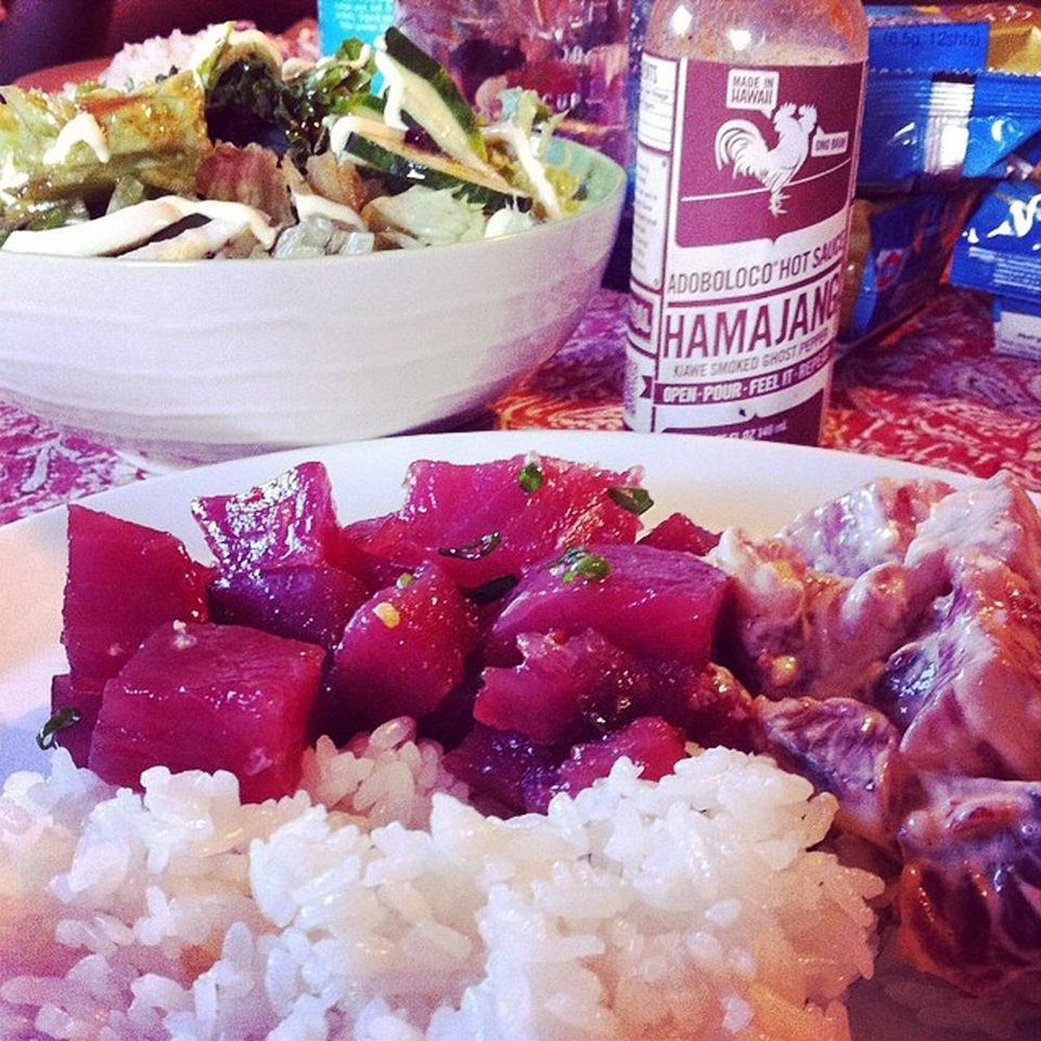 """Photo - This undated photo provided by Tim Fernandes-Parsons and posted in May 2014 to the Instagram account of his company, Adoboloco, features one of his products, Hamajang Hot Sauce, with fresh omemade Aku Poke.  """"We use Instagram to show what we're doing in our lives and outside of the business,"""" says Parsons. (AP Photo/Courtesy Tim Fernandes-Parsons)"""