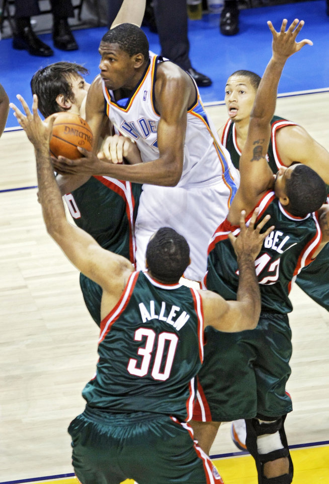 The Thunder's Kevin Durant drives through the Bucks defense during the second half Wednesday.  PHOTO BY CHRIS LANDSBERGER, THE OKLAHOMAN <strong></strong>