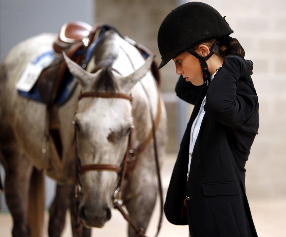 Photo -  Sage Rasmussen gets ready to ride Fury in the Wind in the Hunter Class competition at the Cleveland County Free Fair Horse Show. PHOTO BY STEVE SISNEY, THE OKLAHOMAN   STEVE SISNEY -