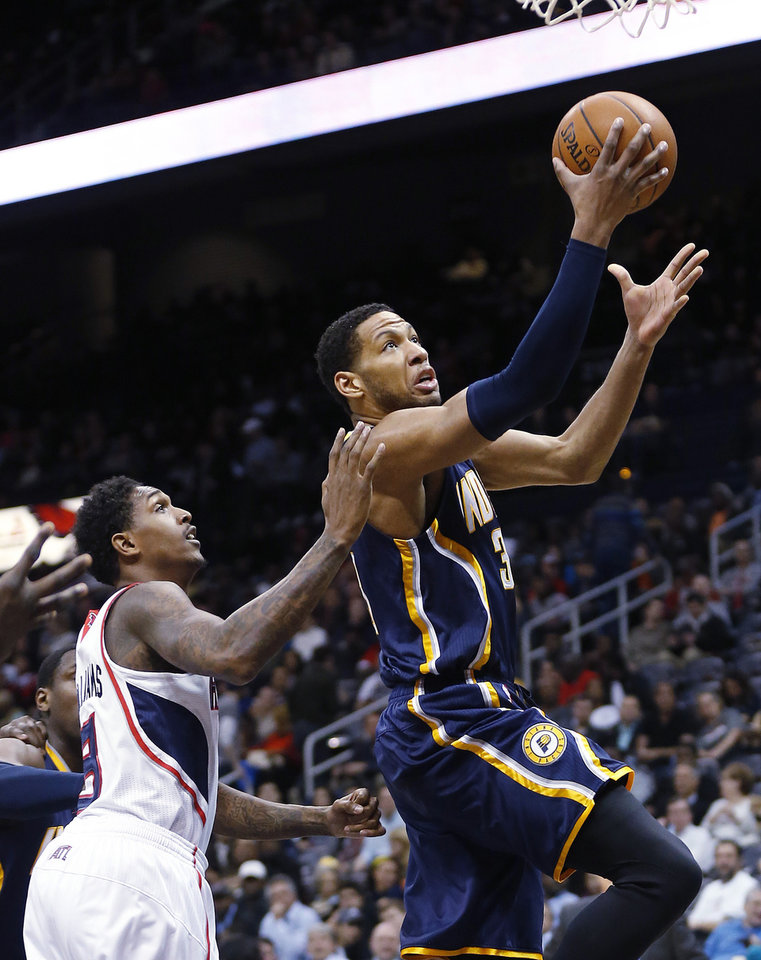 Photo - Indiana Pacers small forward Danny Granger (33) drives to the basket as Atlanta Hawks shooting guard Louis Williams (3) defends in the first  half of an NBA basketball game, Tuesday, Feb. 4, 2014, in Atlanta (AP Photo/John Bazemore)
