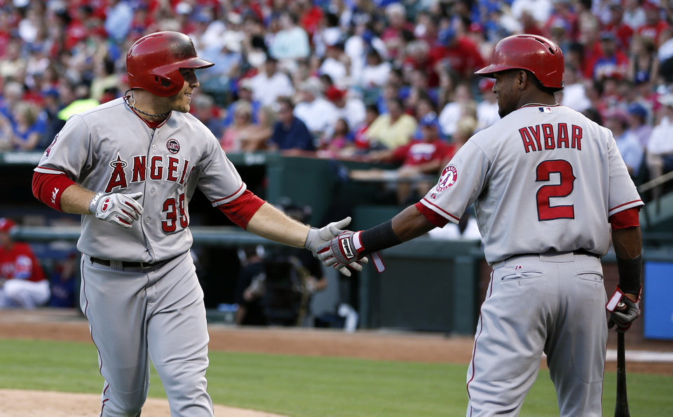 Photo - Los Angeles Angels' J.B. Shuck (39) is congratulated by teammate Erick Aybar (2) after his solo home run against the Texas Rangers during the fifth inning of a baseball game, Monday, July 29, 2013, in Arlington, Texas. (AP Photo/Jim Cowsert)