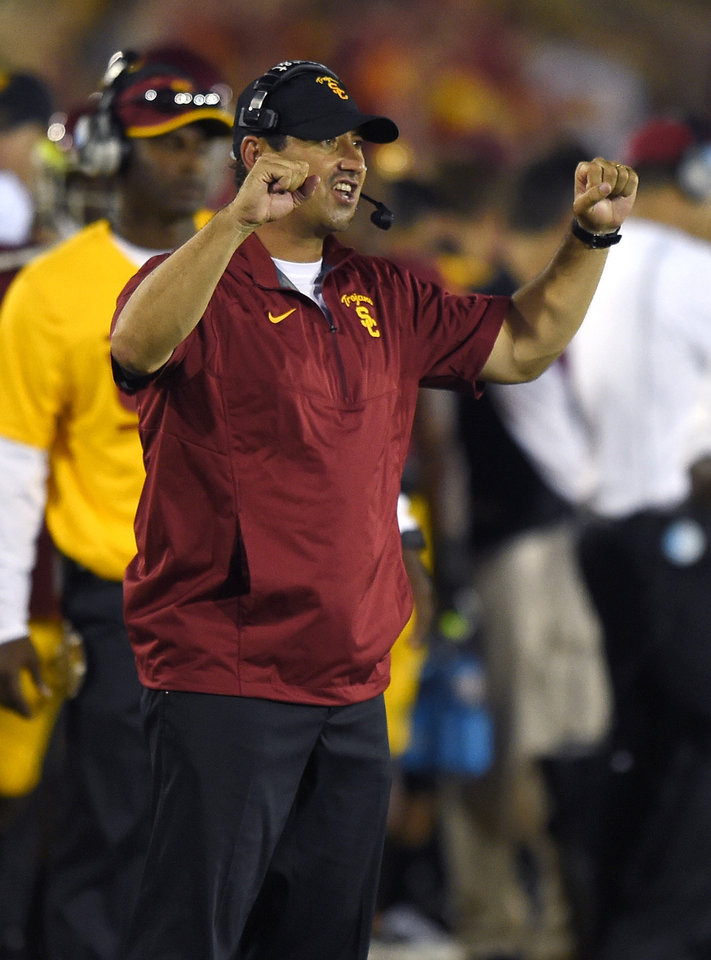 Photo - Southern California head coach Steve Sarkisian celebrates during the second half of an NCAA college football game against Fresno State, Saturday, Aug. 30, 2014, in Los Angeles.  USC won 52-13. (AP Photo/Mark J. Terrill)